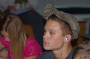 Sophomore Andrew Specht testing the boundaries of the school dress code's prohibitions against headphones and hats. Photograph by Abigail Rundle.
